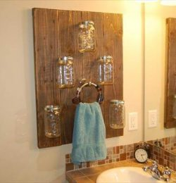 recycled pallet mason jar shelf and towel rack