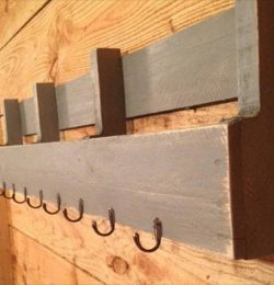 reclaimed pallet shelf with metal hooks