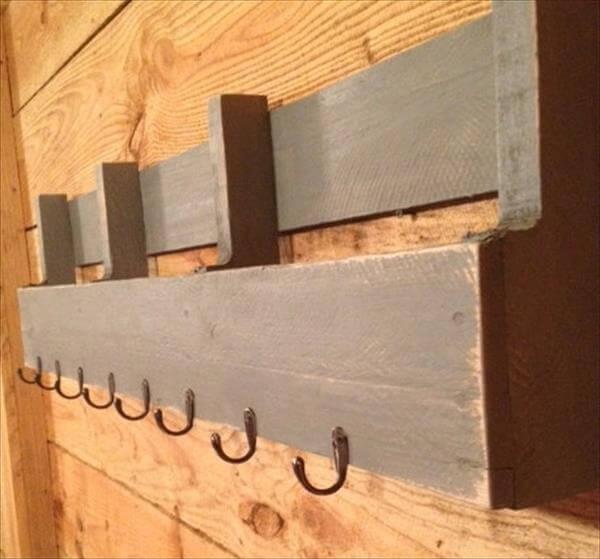 reclaimed pallet shelf with metal hooks