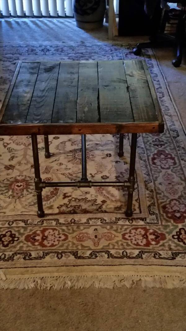 repurposed pallet table with metal iron pipe legs