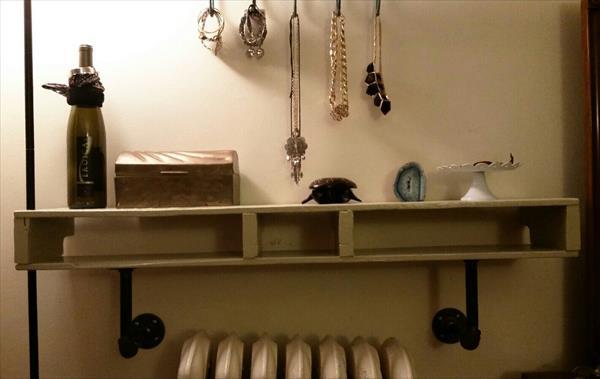 handmade pallet and iron pipe shelf