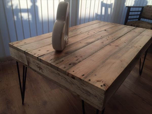 repurposed pallet coffee table with metal legs