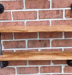 repurposed pallet and iron pipe wall hanging shelf