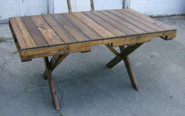 recycled pallet dining table with criss cross legs