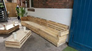 Repurposed pallet full slat sofa bench with tables