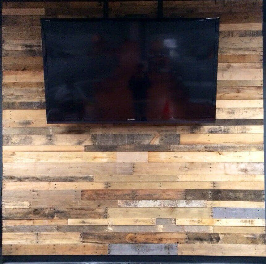 Wood pallet accent wall pallet furniture diy for Reclaimed pallet wood wall
