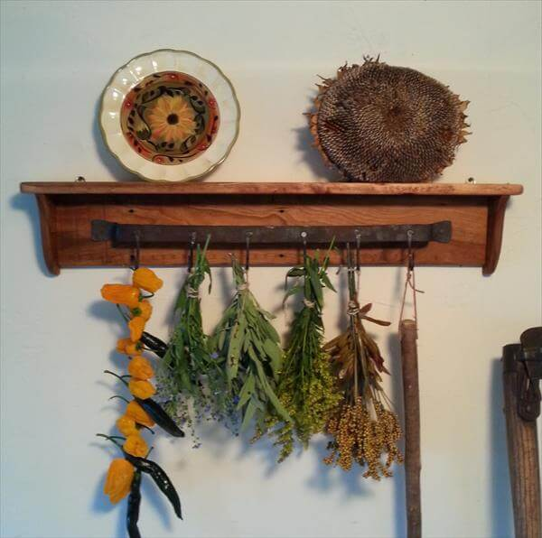 handmade wooden pallet shelf with hooks