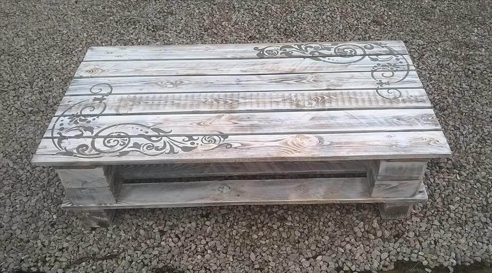 upcycled wooden pallet coffee table with artistic scrolls