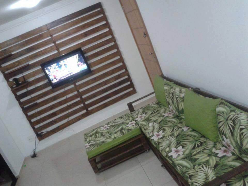 wooden pallet media wall and sofa