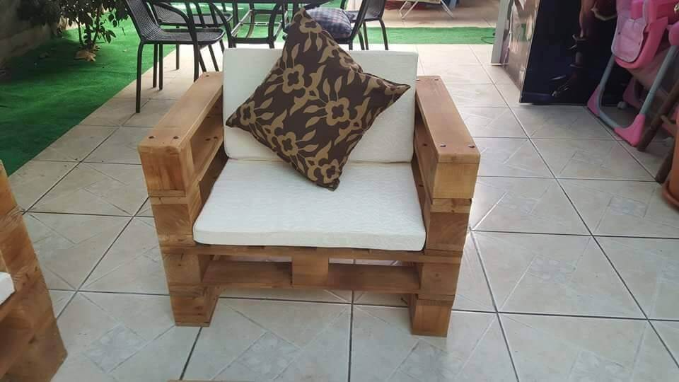 sturdy wooden pallet chair with white cushion