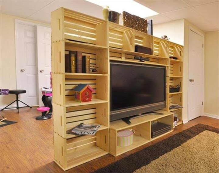 reclaimed pallet wall of shelf and media storage