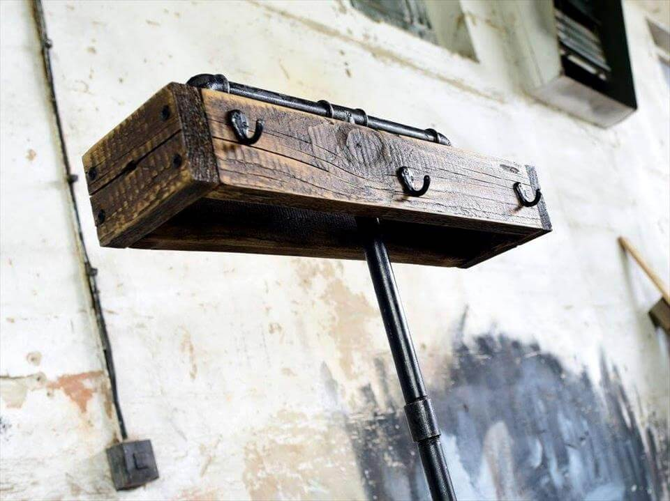 pallet and old metal pipe self-standing coat rack