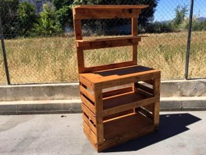 light brown stained pallet potting bench