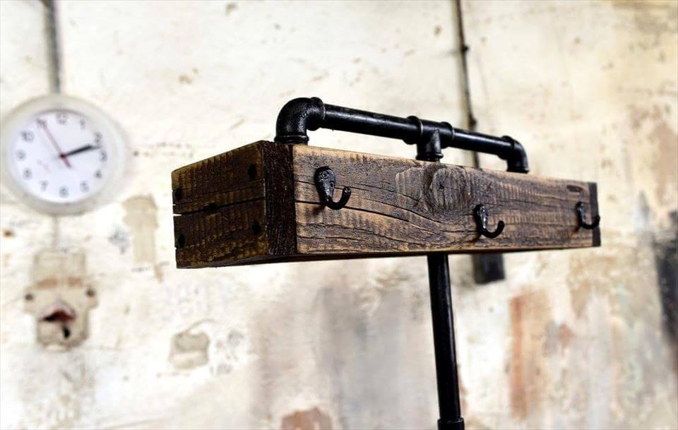 diy wooden pallet and old metal pipe coat rack