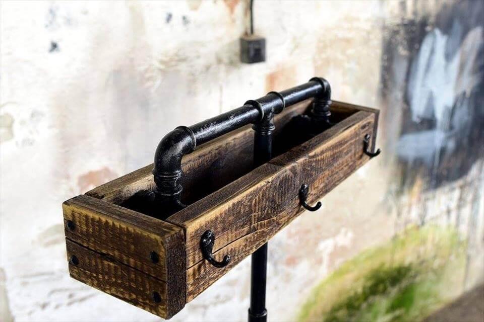 repurposed wooden pallet and old metal pipe self-standing coat rack