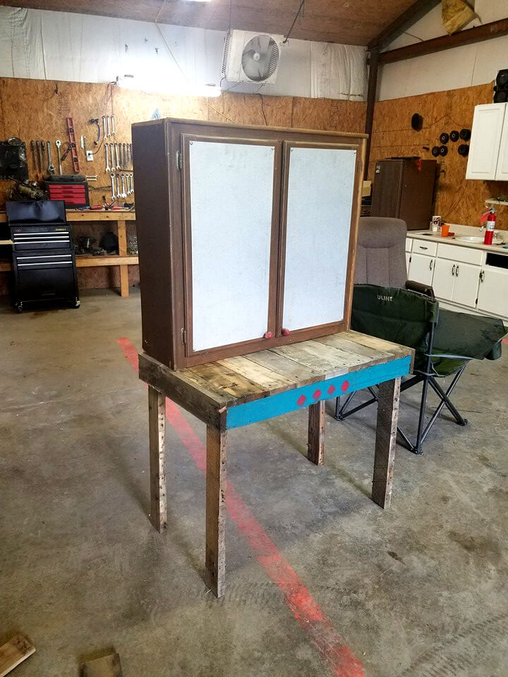 pallet table with storage cabinet on top
