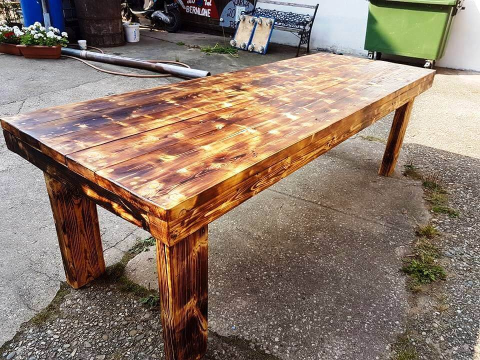 recycled pallet dining table with scorched top