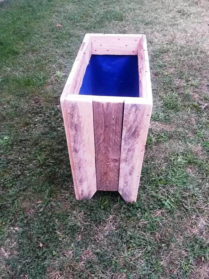 hand-build wooden pallet planter box